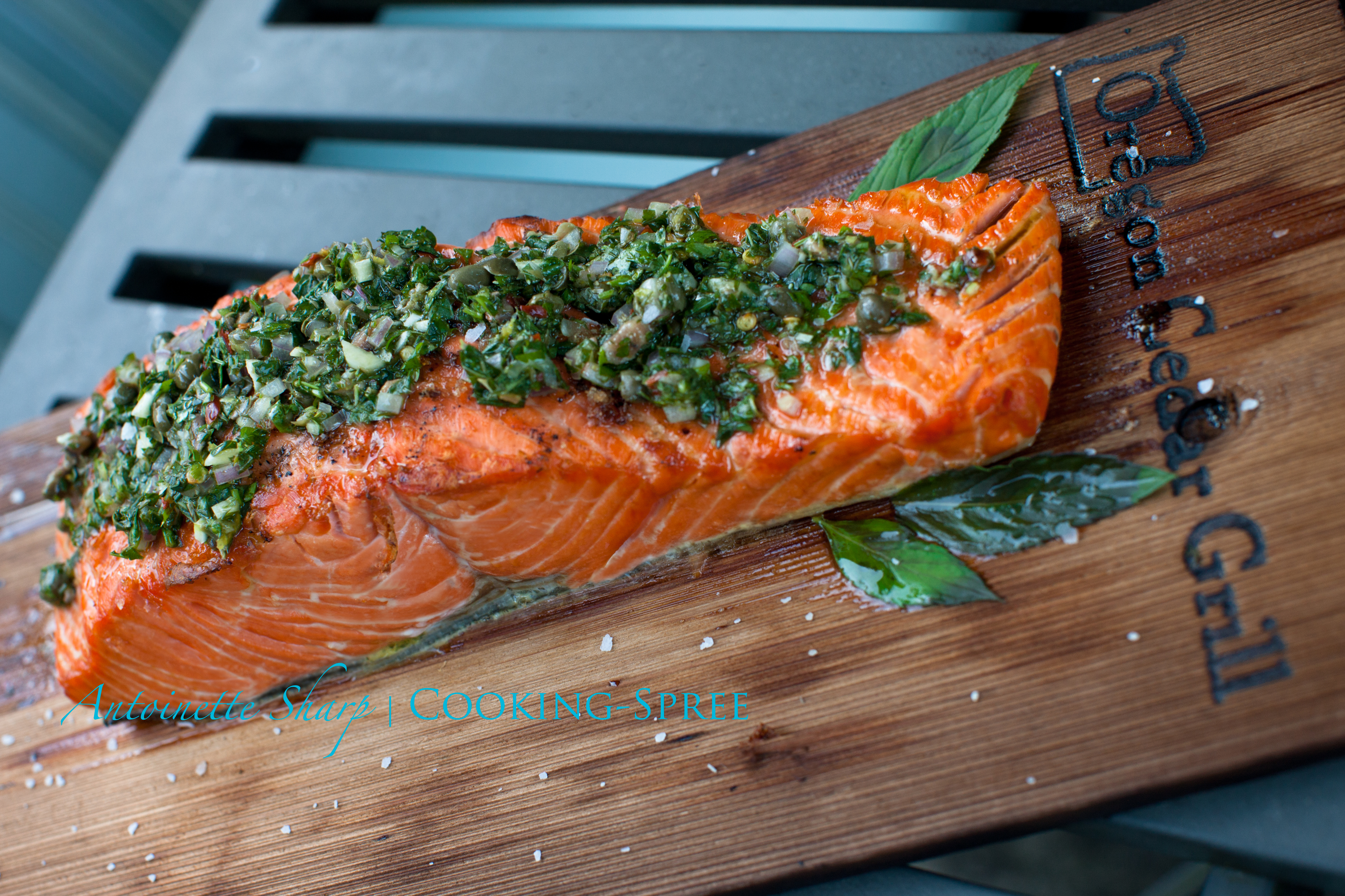 Salmon fillets steeped in the aromas of cedar smoke and steam, then ...